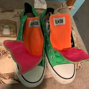 Green converses with Multi color tongues